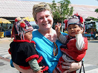 Traveler Linda Nygard with local children