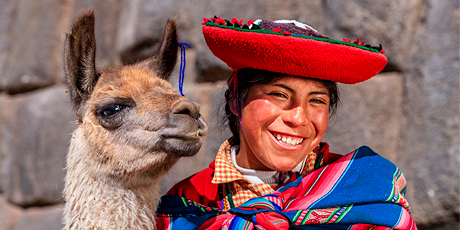 Peruvian girl with an alpaca